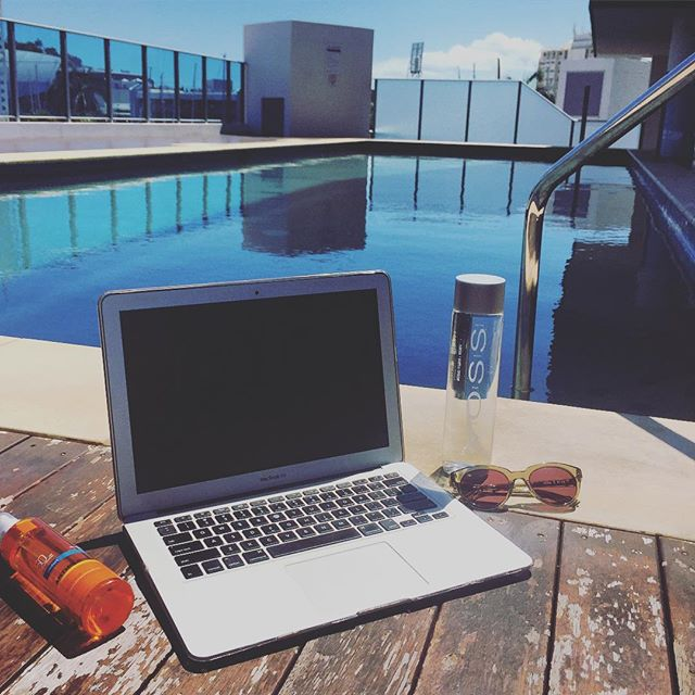 working by the pool